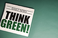 newspaper with 'Think Green!' headline