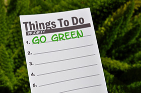 notepad that says go green